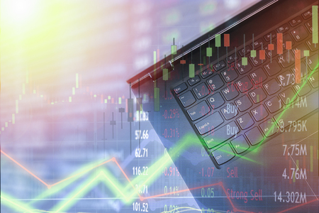 Laptop computer online investor for huge profits.  Bullish market for big payouts and profit  for day traders.