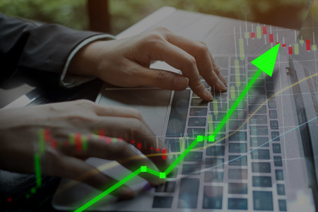 Stock market investing concept with computer laptop keyboard for online business investment.  Risk versus reward for growing economy concept. Stock Photo