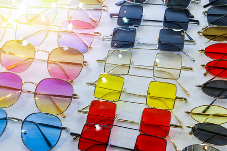 Sunglass shop selling different bright colored funky glasses for UV protection from the sun.  Eye glass online store.