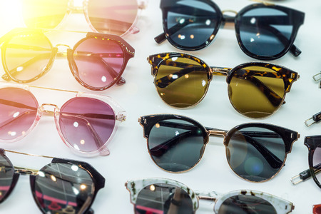 Sunglass shop with glasses and different apparel for peoples eyes to wear for UV protection from the sun.  Various and assorted shapes and sizes of glasses.