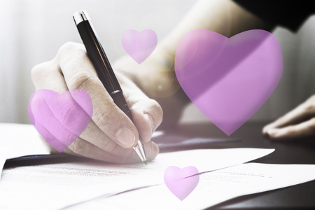 Romantic old fashioned letter wrigint with pink hearts.  Couples idea.