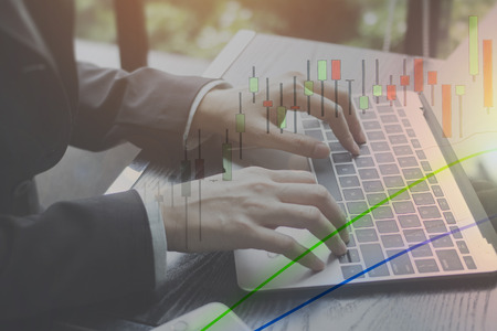 Stock market capital gains from online investing at home.  Learn to invest in the stock market and make money online. Stock Photo
