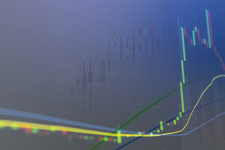 Blue background with rising candle graph for investment and stock market.