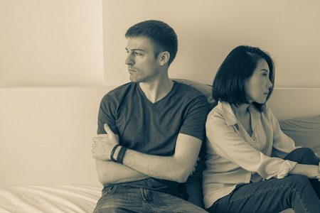 relationship problems between couples and communication issues in dark black and white Stock Photo