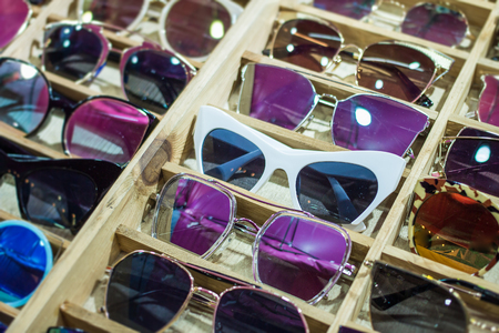 Sunglass shop and different apparel for eyes with colorful accessories and trendy lenses.
