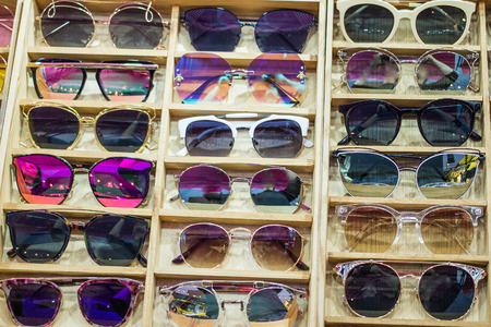 Online sunglass shop and different apparel for eyes with colorful accessories and trendy lenses. Stock Photo