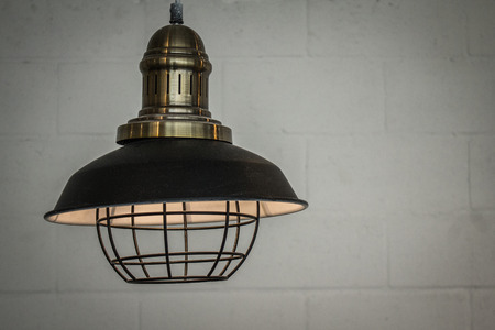 Antique lighting for ambient interior home design.  Old nautical hanging light. Stock Photo