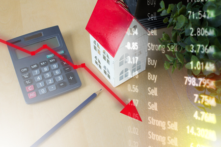 Housing mortgage crisis with unpaid loans and value decrease.
