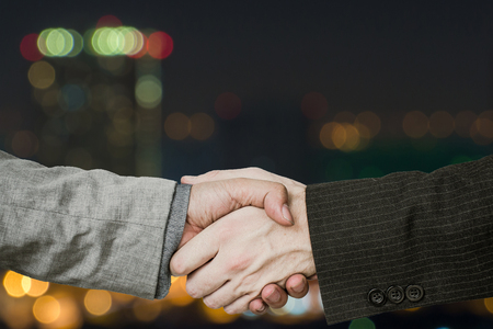 Financial success handshake for investing capital.