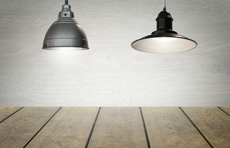 Dual hanging lights for item or product display in open space.  Room for copy space text and words.  Bright studio lighting with professional quality feel.