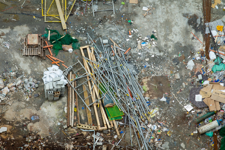 Construction site graphical resource.  Dirty grunge messy construction yard with scattered materials and dirty mess.
