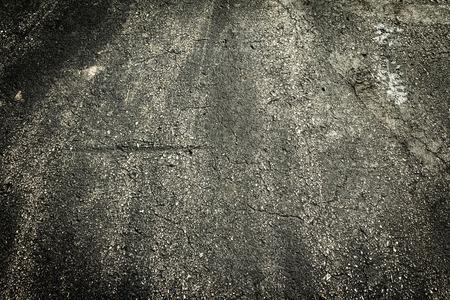 Dark stone asphalt with grimey rustic filth. Stock Photo