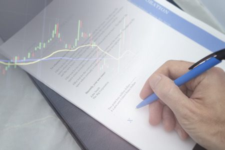 Signature of purchase agreement seals deal and financial gains on investments begin.  Massive profits with new deal. Stock Photo - 112196760
