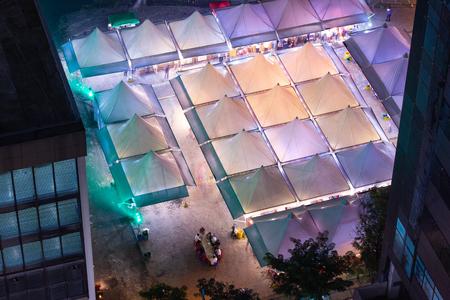 Street fair night life concept aerial.