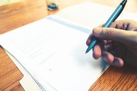 Rental contract agreement for review and signing.  Signing a lease or rental contract.