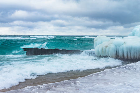 Icy cold antarctic waters splashing during winter storm.  Cold climate.