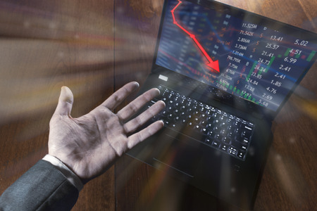 Stock price falls in the red and crashes as bear market leads to finance crash. Stock Photo
