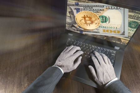 Crypto investing at exchanges online.  Money investment concept with hands on a laptop.