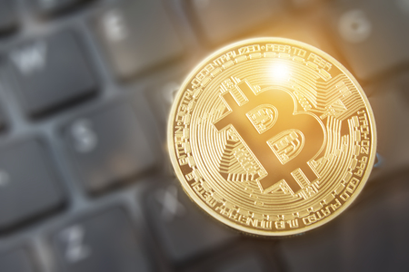 Bitcoin currency blockchain mining technology and internet trading bitcoin and crypto at online exchanges.  Copy space room for wording. Stock Photo
