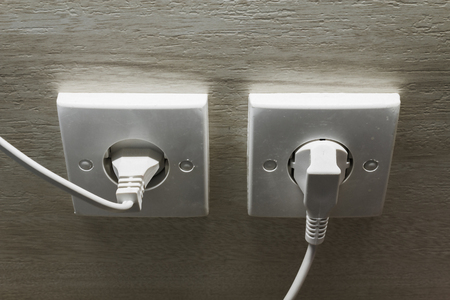 Electric wall plugs for 120 or 240 volts concept. Wall outlet for energy consumption. Electrician. Copy space. Stock fotó