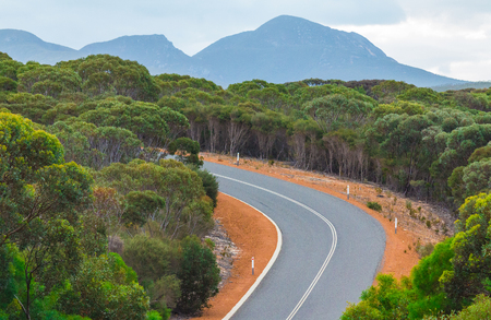 Natural scenery on the open road in Australian Outback.  Freedom and orange red road.