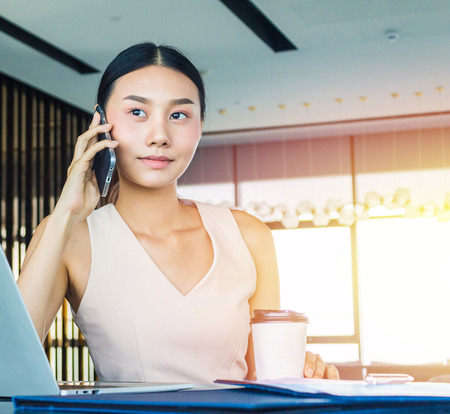 Business woman on a phone call in office.  Communication and contact concept.