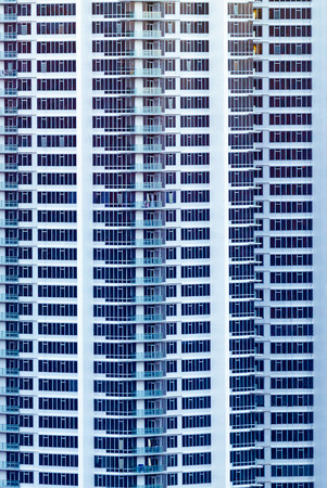 Highrise enormous condo building facade in white.  Ultra modern.