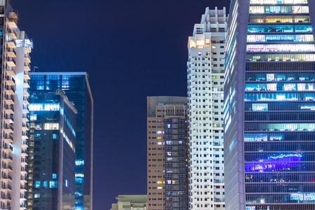 Apartment windows at night in big city highrises. 스톡 콘텐츠