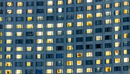 Hotel windows at night.  Travel concept for big luxury hotel chain. Stock fotó