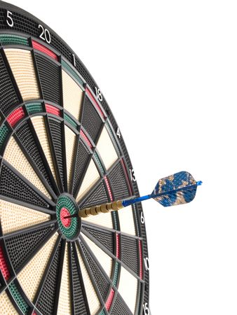 a dartboard with a dart hitting the bullseye in the center of the board.