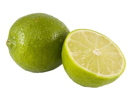 a close up on a fresh lime cut in half isolated on a white background