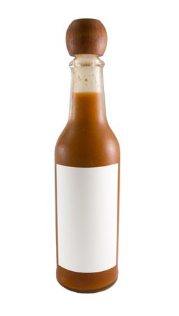 a close up on a bottle of red hot sauce with a blank label