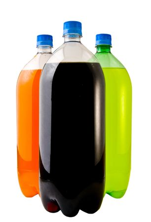 A close up on three soda bottles isolated on a white background. Imagens