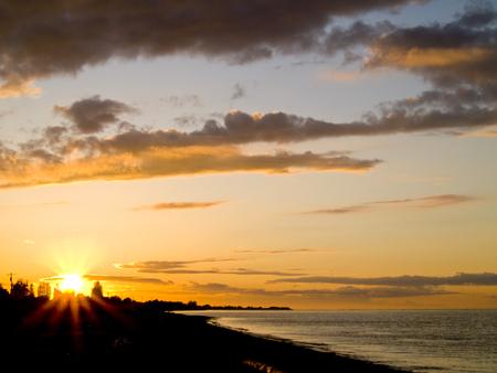 strait of juan de fuca: A golden sunset over the Strait of Juan de Fuca in Sequim, Washington.