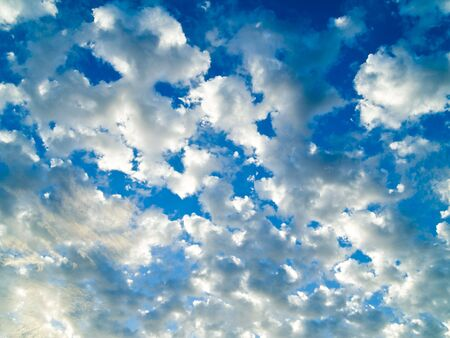 A surreal cloudscape with a bright blue sky in the background. Reklamní fotografie