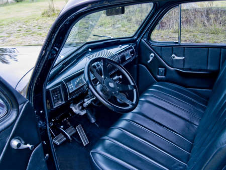 A close up on the interior of a classic car. photo