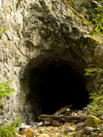 The entrance to a large cave in the Pacific Northwest.