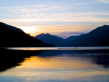 wa: The sunrise over a lake in the Pacific Northwest.