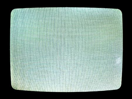 A close up on a television screen switched to a channel with poor reception.