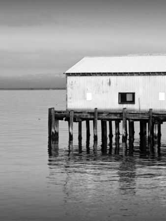 unoccupied: An old abandoned building on a pier in the Pacific Northwest.  Stock Photo