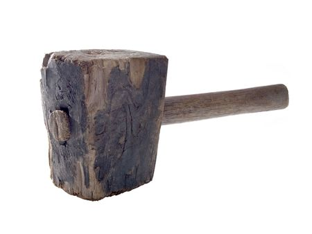 A close up on an old wood hammer isolated on a white background.