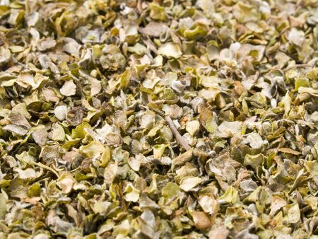 A close up on a pile of dried Marjoram.