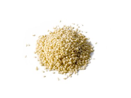 A close up on a pile of dried Sesame Seed isolated on a white background.