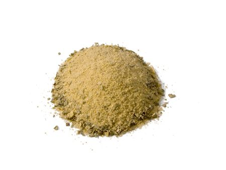 A close up on a pile of Poultry Seasoning isolated on a white background.