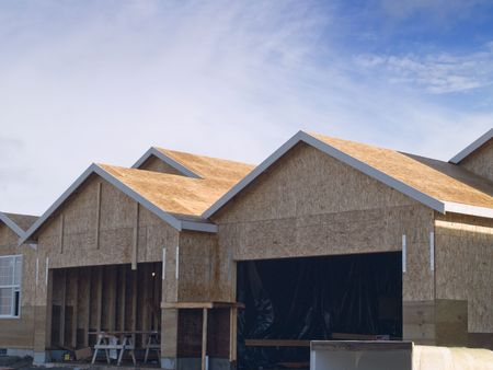 duplex: A new house being built on a warm sunny day.