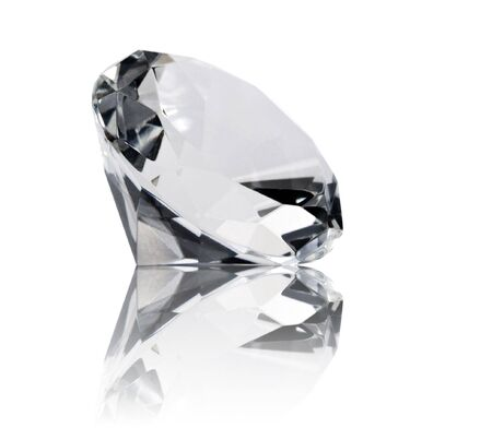A close up on a diamond isolated on a white background. Shallow DOF.