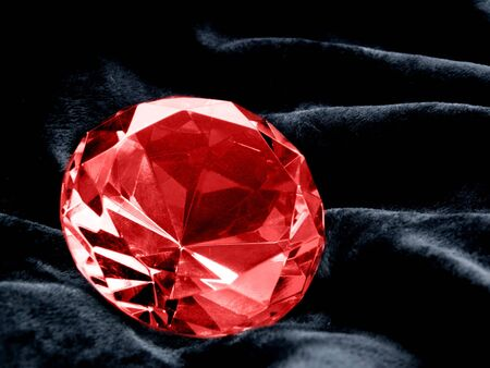 A close up on a Ruby jewel on a dark background. Shallow DOF.