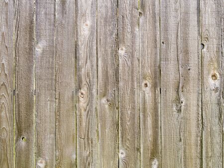 A close up on an old wood fence background texture. Standard-Bild