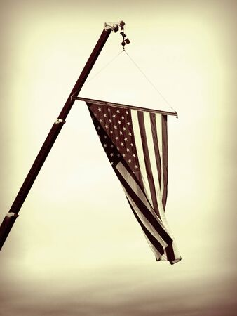 A close up on the American flag suspended from a crane.