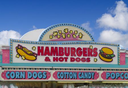 A close up on a food sign at a fair.
